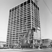 The Arcade Building being demolished, with IITRI Tower in the background